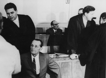 Josef Windeck (seated), accused and convicted of murder, seen in the courtroom during the 