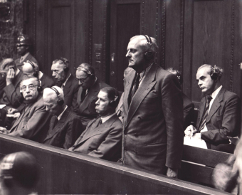 Otto Ambros (standing) during the pronouncement of the judgement in the I.G. Farben Trial in Nuremberg, July 29/30, 1948