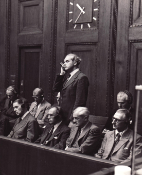 Walther Dürrfeld (standing) during the pronouncement of the judgement in the I.G. Farben Trial in Nuremberg, July 29/30, 1948